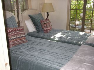 Carmel cottage photo - Bedroom 2 has twin xl beds and opens out to a cozy patio