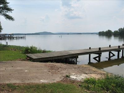 Boat ramp and pier have mountains in background