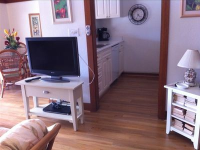 Enjoy the large flat-screen tv and dvd player. The kitchen is large and open.