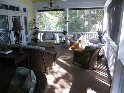 Screened porch area outside master bedroom, wicker table for morning coffee