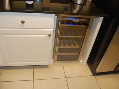 New kitchen cabinets with new wine refrigerator
