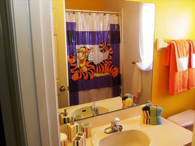 Kid's Full Bathroom with Winnie the Pooh theme.