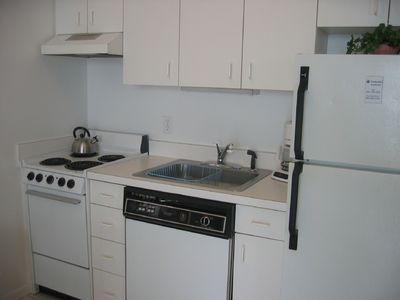 Fully-equipped kitchen with cooking & dinnerware