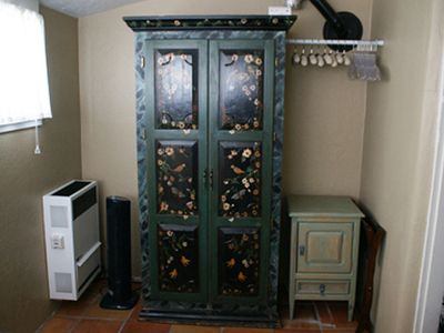 Handpainted armoire originally from historic hotel has 19' TV in twin bedroom
