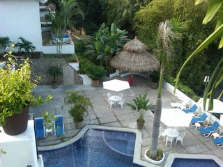 Puerto Vallarta condo photo - Main salt water pool. Lots of deck chairs and a large palapa offers some shade.
