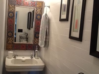 "Charming upstairs half bath ""water closet""."