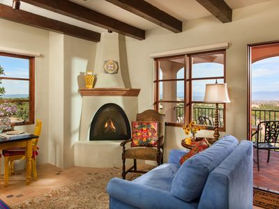 Santa Fe apartment rental - Sitting room with kiva gas fireplace and views to the Jemez Mountains.