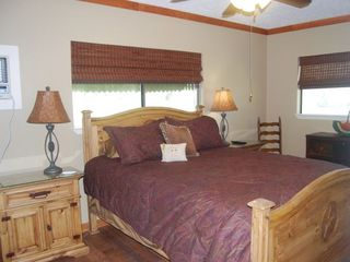Bastrop cottage photo - Master bedroom, queen bed, flat screen TV entry into bath.