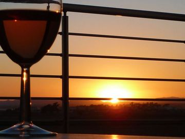 Relax with a glass of wine on the balcony