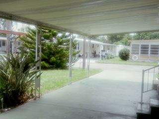 New Port Richey mobile home photo - Car Port looking out to Street
