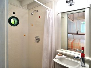 Key West house photo - The Guest House has en-suite bathroom with shower, no charge for the porthole.