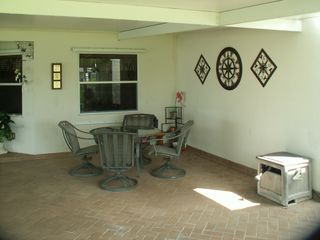 Okeechobee house photo - Covered carport with brick paver flooring