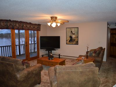 Living Room with big screen television, DVD and wireless internet.
