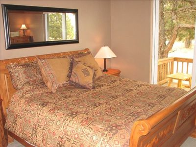 King bed in master suite with private deck