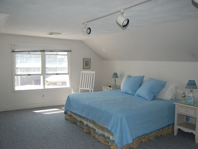 large master bedroom with king size bed and lovely ocean views