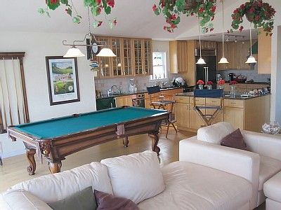 Large living area with pool table, dining table, TV den