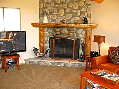 Wood burning fireplace and flat screen TV
