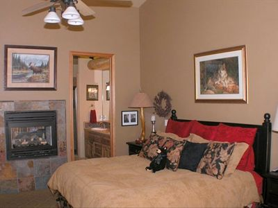 Master suite has king bed, fireplace and direct access to hot tub on upper deck