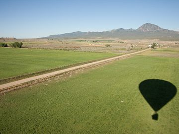 Hot air ballooning towards the Sleeping Ute Mountain south of Cortez.