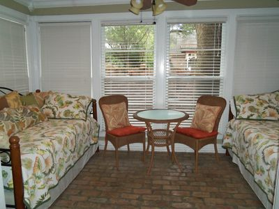 Sun room with two twin daybeds and two twin trundle beds.