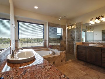 Master bath with double sink, shower and garden tub.