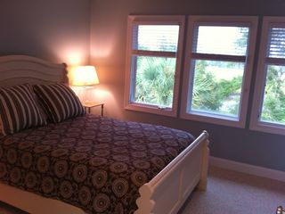 Bald Head Island house photo - An upstairs queen master bedroom, the TV is not in view