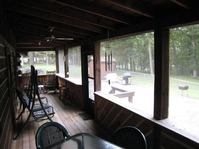 Table for six for outdoor dining also on the lake side screened porch