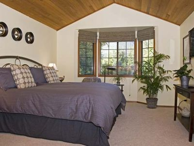 ...Retreat to the Romantic 'River Rock' Master Bedroom w/ Mount Si Views