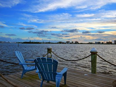 Sunset House Waterfront Dock & Chairs await you........