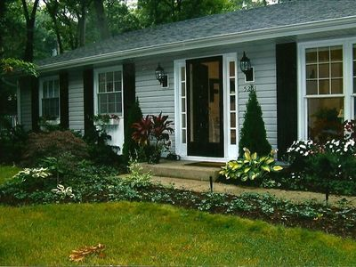 Charming country cottage with beautifully landscaped yard.