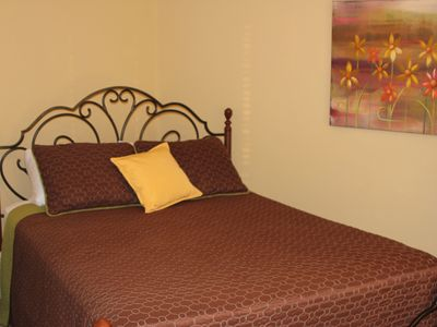Queen size bed in the Master Bedroom
