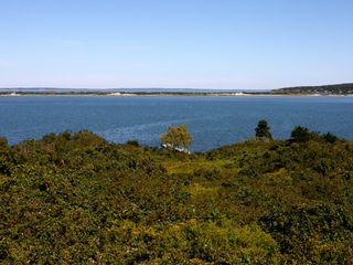 Chilmark house photo - View of private dock and pond from deck