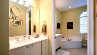 Marco Island house photo - Master bath, two sinks, sunken tub, walk in tile shower with rain shower head.