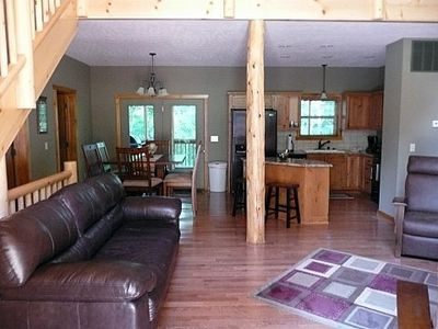 Branson house rental - Main floor with open great room / kitchen / dining and screened in porch