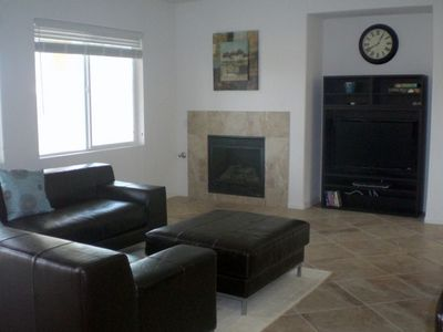 "Great room with gas fireplace and 42"" television, cable, and dvd player"