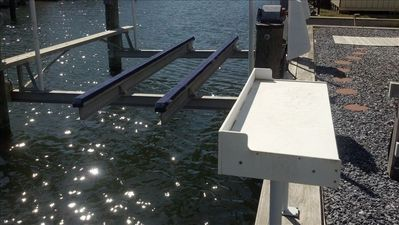 Boat lift and fish cleaning station with available water at dock.