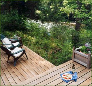 Enjoy the view of the river through the trees while you eat on the deck