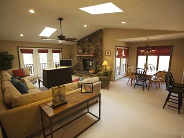 Lake Ouachita condo rental - Spacious living and dining area with huge sectional sofa, and stone fireplace