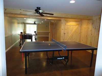 Finished basement has fusball, ping pong, library, lg screen tv, and futon