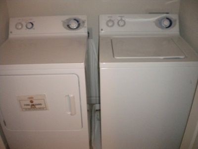 Full size washer and dryer next to master bedroom