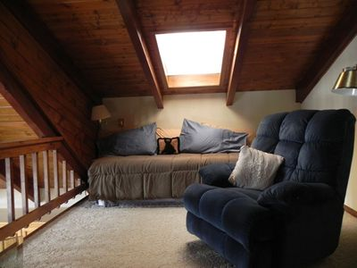 The loft with trundle daybed and recliner.