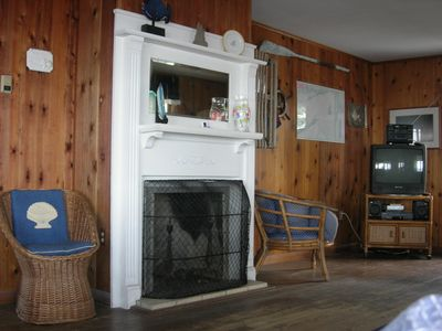 Living Room also features lovely fireplace and mantel and a spot for TV