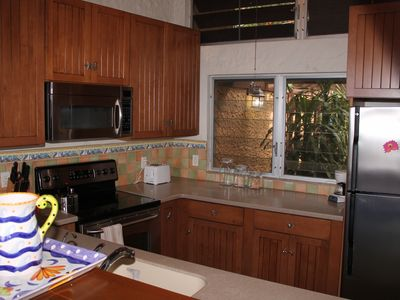 Gourmet kitchen with ss appliances and all necessary amenities.