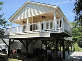 Wonderful Location in the Park! Swings under the house and Deck Furniture!