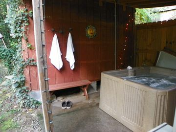 Step out the back door to an inviting, sheltered outdoor hot tub.