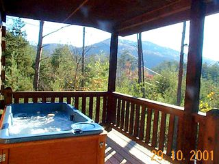 Hot-tub on front covered porch viewing panoramic mountain view - Pigeon Forge cabin vacation rental photo
