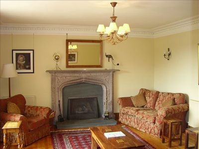 Sitting Room with open log fire and window seat