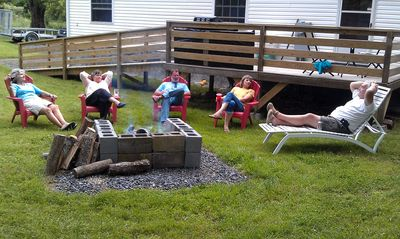 Friends gathered around fire pit.Kick back & RELAX!