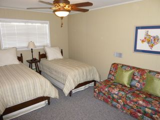 Brenham estate photo - Large upstairs bedroom (2 twins, double sofa bed)