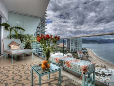 the beachfront terrace with a view to downtown Puerto Vallarta